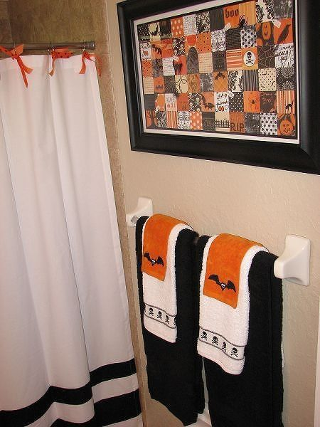 fall bathroom decor by simply switching hand towels and ribbons to tie the shower curtain - Halloween Bathroom Decor