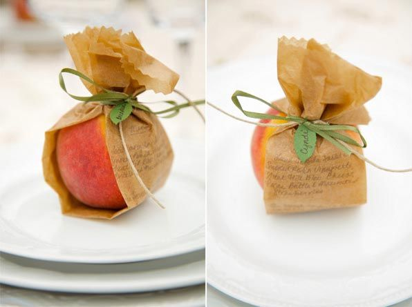 A paper wrapped peach. Simple party favors are my favorite. It acts as a place-setting name holder too.
