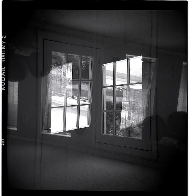 Double exposure created with Holga film camera.