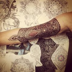 This is an awesome way to turn a henna-style tat into a sleeve. Love the shape of it - turned geometric patterns into an asymmetrical shape, By Saskia Chowles at Inka, Brighton, UK
