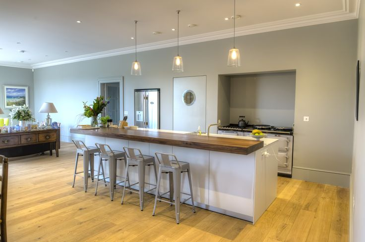 bulthaup b3 kitchen in Alpine White laminate with a solid walnut breakfast bar. Corian worktops from Counter Production