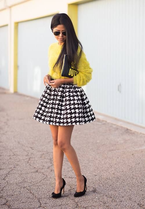 Mention @lookastic in a comment to a pin to make it shoppable. Shop this look for $71:  http://lookastic.com/women/looks/clutch-and-skater-skirt-and-pumps-and-sunglasses-and-crew-neck-sweater/2775  — Black Print Leather Clutch  — Black and White Houndstooth Skater Skirt  — Black Suede Pumps  — Black Sunglasses  — Yellow Fluffy Crew-neck Sweater