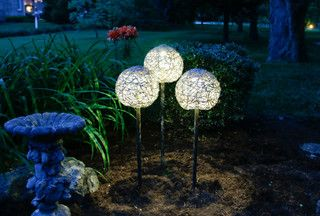 DYI handmade solar garden lights out of twine, a plastic toy ball  & pipe