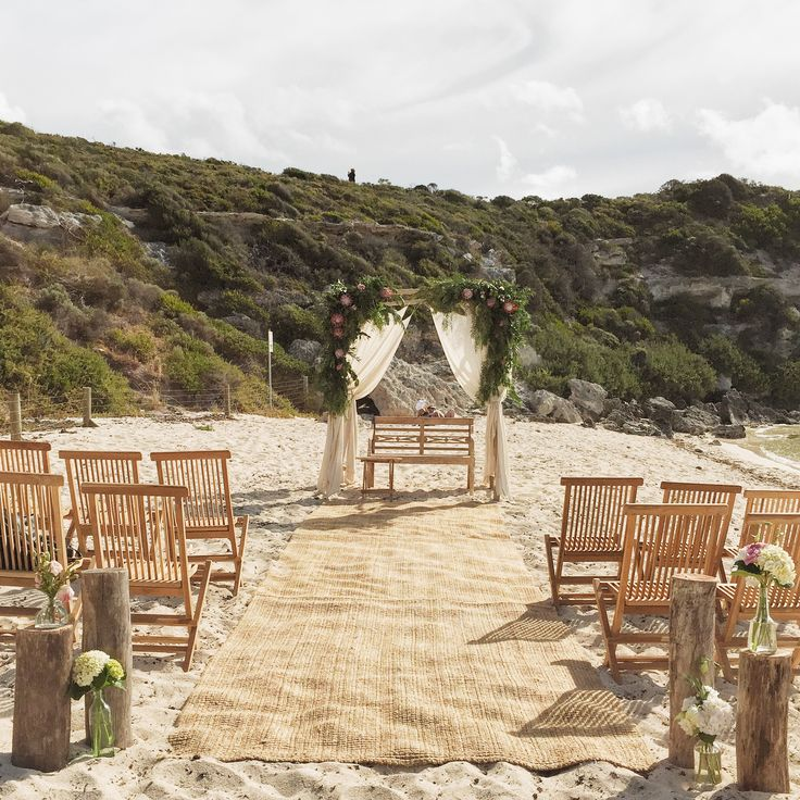 Ceremony set up with driftwood arbour and native additions from Zest Flowers. Furniture by Empire Events.