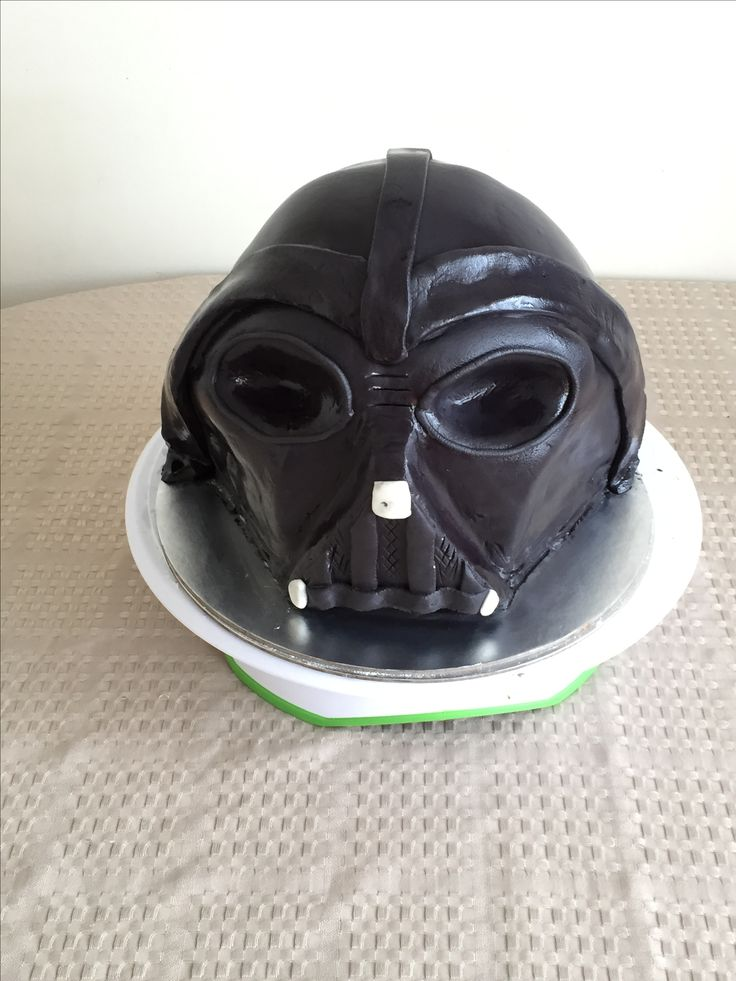 Attempted a darth vader cake.. slightly failed, was too lazy to bake more cake to add more height on helmet top chocolate cake with ganache & homemade fondant #darthvader or is it an #alien