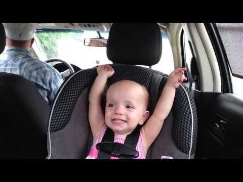 This kid knows how to have fun on a car ride!
