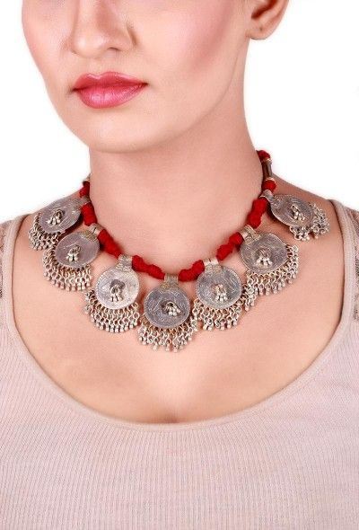 Maroon vintage silver coin thread neacklace Dimension: L: 10 inches Weight: 94 grams Color: Maroon Material: Vintage silver & cotton thread Finish: Hand-crafted Inspiration: Rabari Tribe, Kutch Gujarat