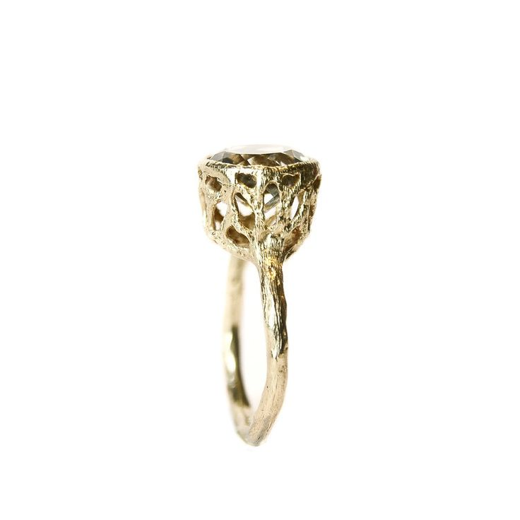 Stoned Collection    Big hollow ring, imperfect by choice and sophisticated in essence allows light beautifully seep through due to translucency of the stone that is meticulously surrounded by a golden lace body. Extremely elegant and hip at the same time, lustrous and comfy. Ancient mood with a modern twist.    The stone is high quality prasiolite.     Stone size: 10mm