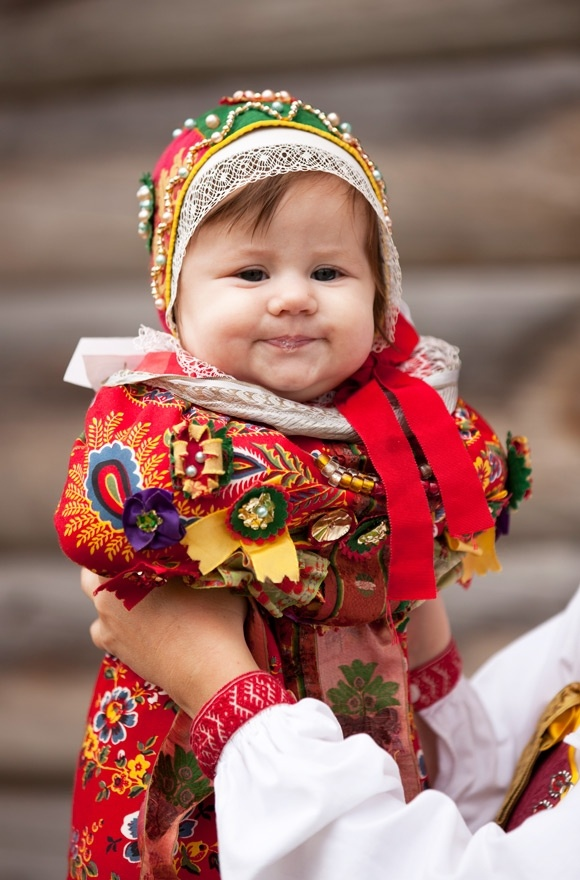 A Swedish baby dressed in the traditional attire. The fashion of #Sweden is vibrantly colorful. Fly to Sweden with the lowest airfare from iEagle.com and experience the traditional culture.