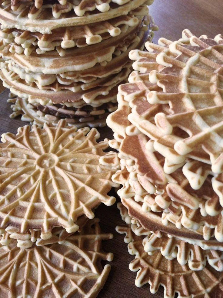 Pizelles - Pizelle are cookies from the Abruzzo region of Italy, and are commonly eaten during Christmas, Easter, and during weddings. For recipe visit: http://allrecipes.com/recipe/pizzelles-ii/