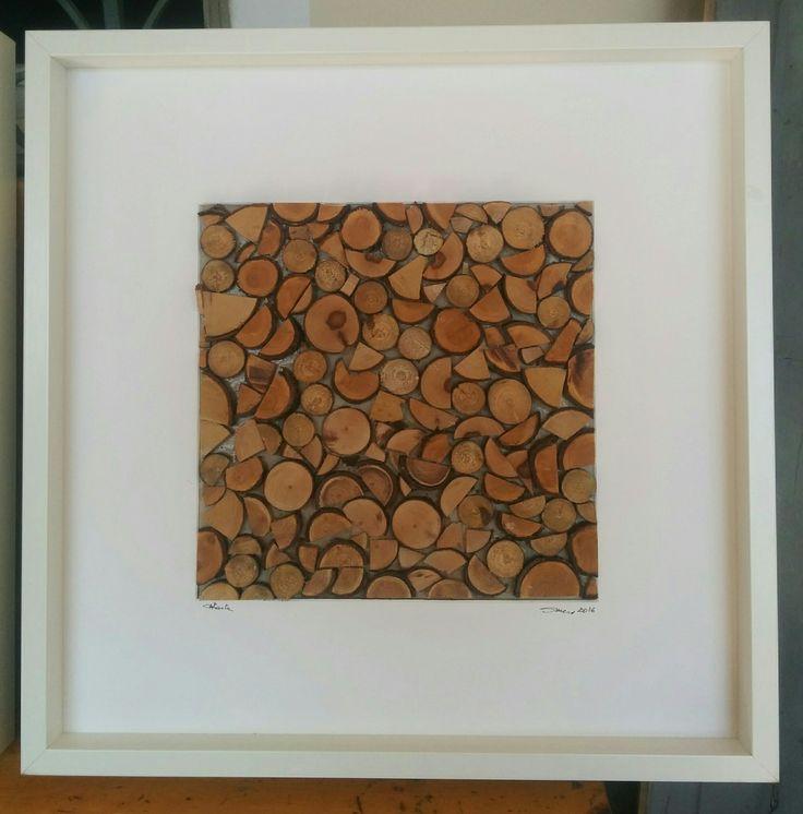 Catasta. Il quadro è stato preparato assemblando dei dischetti di legno ricavati da scarti di potatura.