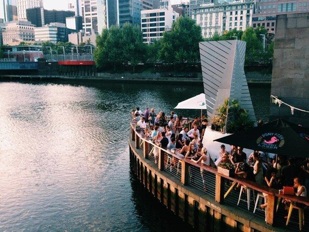 Ponyfish Island |There's looking at a river, and then there's being on a river. Built under Pedestrian Bridge over the Yarra, water laps at the edges of the bar that serves up good wines, beers and tasty food. Expect to settle in for a while. Community Post: 17 Melbourne Bars With A Killer View