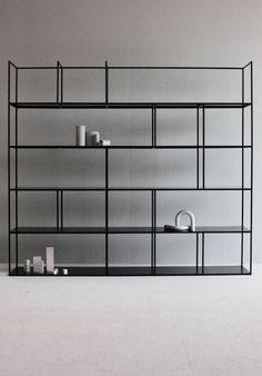 """""""The Mod shelving system reinterprets early industrial shelving units, with its minimalistic restrained design. Originally conceived as an office shelf, it also finds its way into the living room. Constructed from square steel tubing and sheet-metal, the lightweight frame is used to suspend thin shelves"""" - DANDY ON DESIGN - (Unique """"Mod"""" Shelving System by Barbera Design)"""