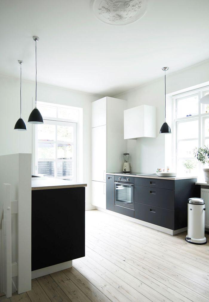 Modern black and white kitchen with linoleum kitchen cabinets