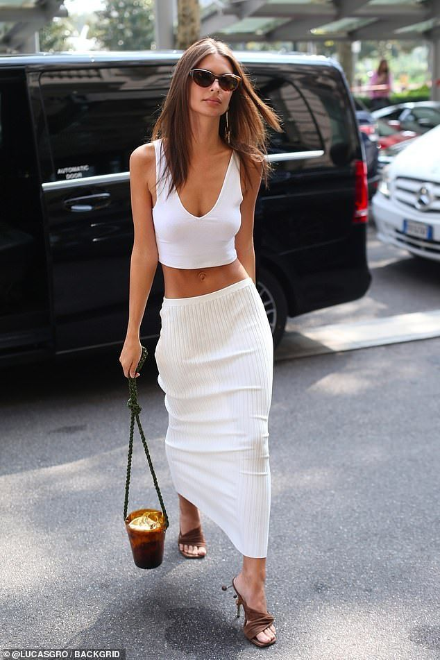 d879d78e10c Revealing  Emily Ratajkowski was showing her toned abs in a skimpy white  crop and matching skirt on Friday as she stepped out in Milan
