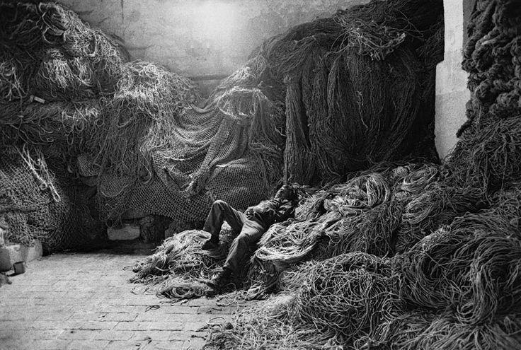 Fisherman resting. The Mattanza, traditional tuna fishing. Trapani, Sicily, Italy . 1991 By Sebastião Salgado