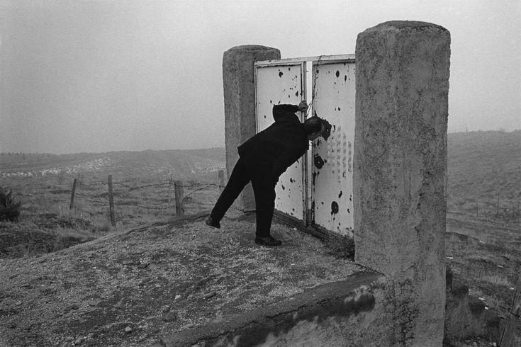 "ABBAS :: film director Abbas Kiarostami on the hills surrounding the capital, where his film ""Taste of Cherry"" was shot. Tehran, Iran, 1997"