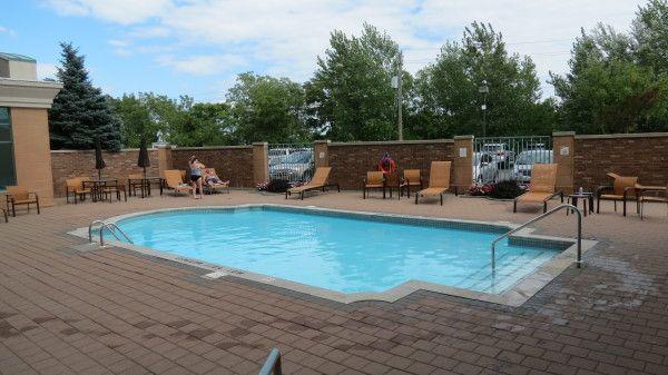 Outdoor heated swimming pool at Courtyard Marriott Niagara Falls in Ontario, Canada