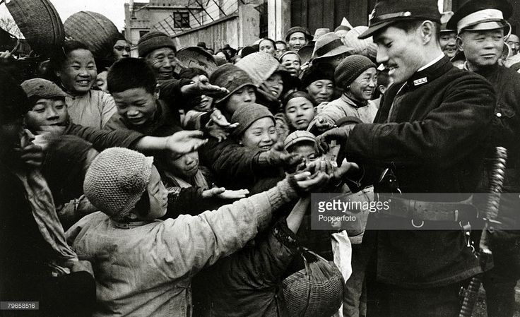War and Conflict, Sino-Japanese War, (1931-1945), A Japanese propaganda picture showing a Japanese soldier distributing sweets to Chinese children in an occupied town, Following the two countries conflict at the end of the 19th century, further hostilities developed after the Manchurian Incident of 1931 when the Japanese Army occupied Manchuria and set up the puppet state of Manchukuo, pressing the Chinese to recognise the independent state of Manchukuo and cease anti-Japanese activities…