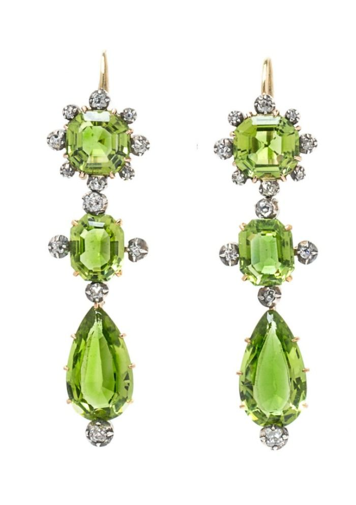 An unusual and beautiful pair of antique peridot and diamond earrings.