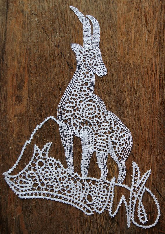 """""""Great Mountaineer."""" Bobbin lace by Jakica, of Idrija, Slovenia. It is made with white and gold thread only and it measures 33x25 cm (about 13 x 9.8 inches). About 16 hours of work-- beautiful!"""