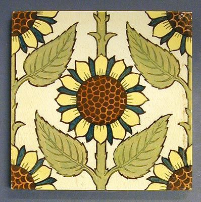 "Maw and Co transfer printed and tinted dust pressed tile with a vertical design of sunflowers in Arts and Crafts style, brown print with polychrome tinting, 6"" square, c1890. The design is similar to one produced in ythe Netherlands for Thomas Elsley and Son, Portland Metal Works, London, which was itself based on a William de Morgan design."