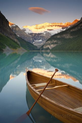 Canoe on Lake Louise at Sunrise, Lake Louise, Banff National Park, Alberta, Canada