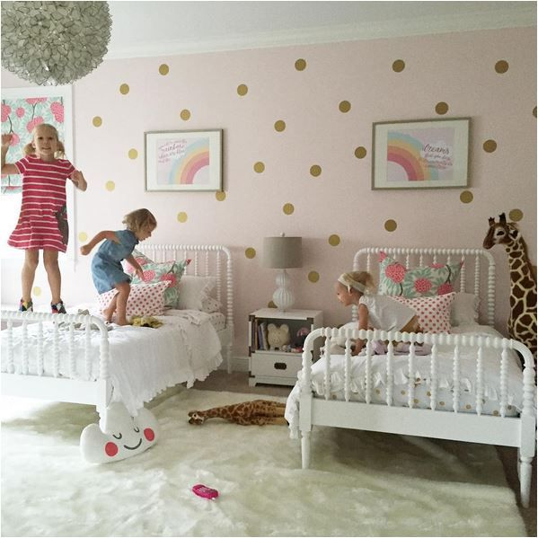 shared girls room with polka dot walls jenny lind beds