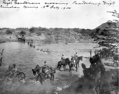 The 2nd (Special Service) Battalion, Royal Canadian Regiment of Infantry crosses the Modder River at Paardeberg Drift on 18 February 1900 to begin the assault on the Boer positions down-river to the east (or right — out of the range of the picture).