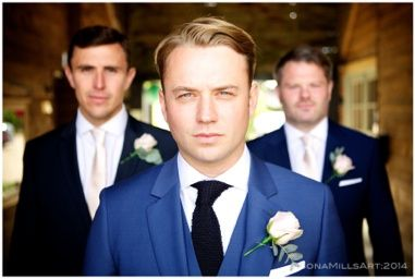 Groom and his best men. Groom style. Wedding day style. Ushers, getting ready, almost at the ceremony. Bold, statement wedding day photography. Saturated and vibrant colour edit. Blue suit, black textured tie, blond short hair, side swept make style.