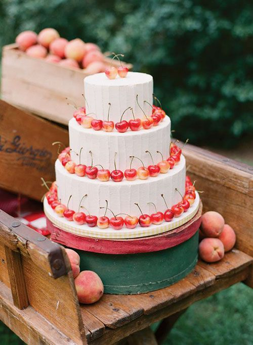 Wedding cake with cherries | Brides.com | Photo: Eric Kelley Photography