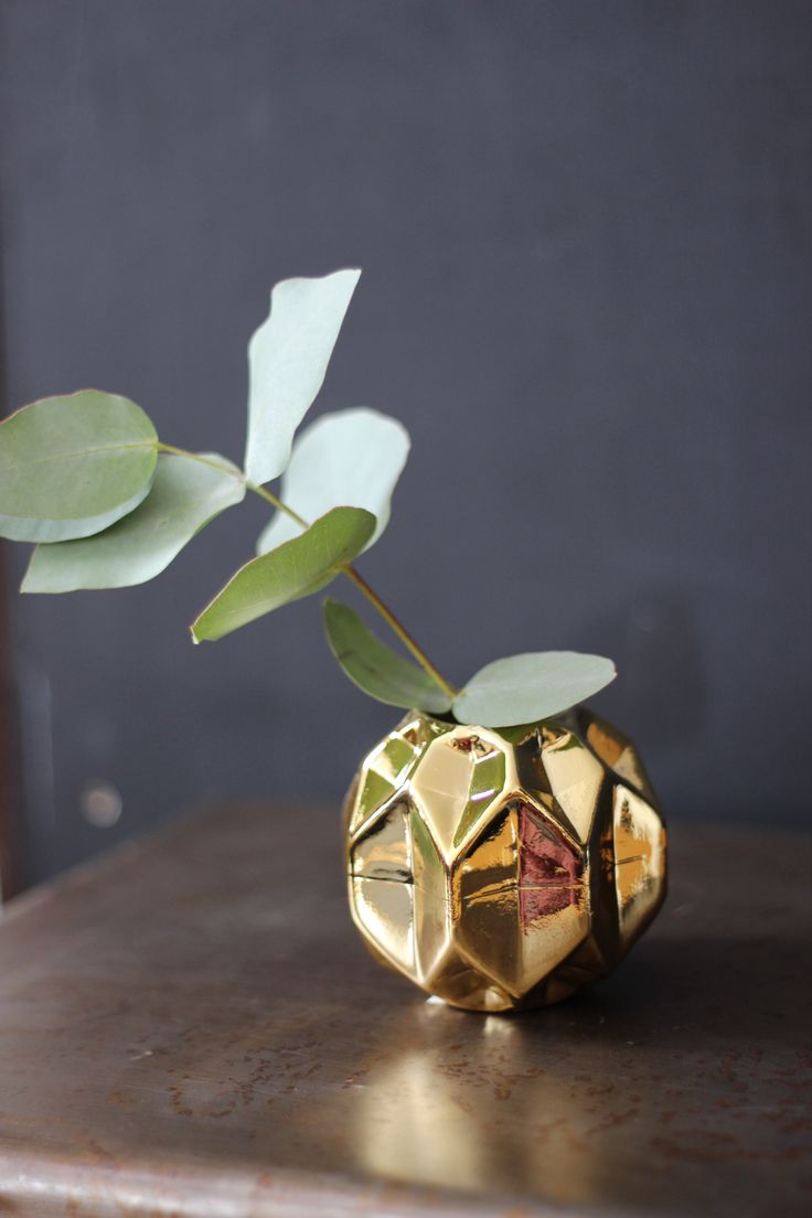 Gold is one of those wonderful hues that adds so much warmth and light to a space. http://www.aprilandthebear.com/home-accessories/flex-gold-vase