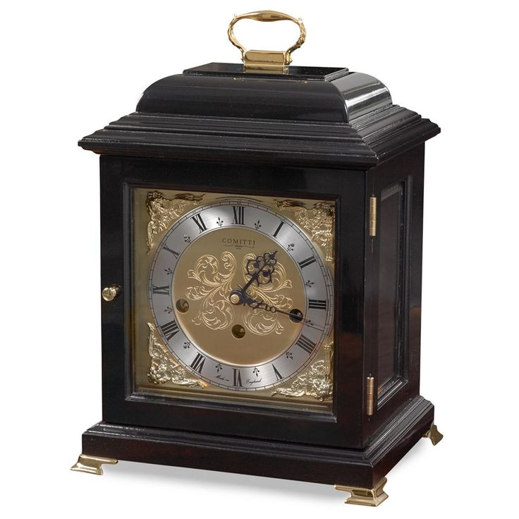 Popular early Georgian style (circa 1705) mantel clock. Black lacquered piano finish cabinet handpainted with goldplated brassware. Polished triple chime eight-day movement with nine-jewel platform escapement and chime silencer. Automatic night silencer and chime sequence correction. Plays Westminster, Whittington and St. Michael melodies on rods. Solid brass dial with cherub spandrels, silver finish chapter ring and fine milled hands. Beveled glasses and goldplated solid brass furniture…