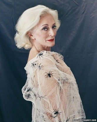 Surround yourself in a shawl of spiders. Weave your web with a roll of white or ivory cheesecloth. Unroll the cheesecloth and spread it out, pulling apart and snipping the ends to achieve the desired distressed appearance. Secure plastic spiders, by applying a small dab of hot glue to each, and pressing onto cheesecloth.