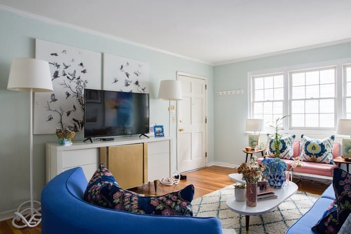 House Tour: A Colorful Vintage Charleston Apartment | Apartment Therapy -- art behind tv