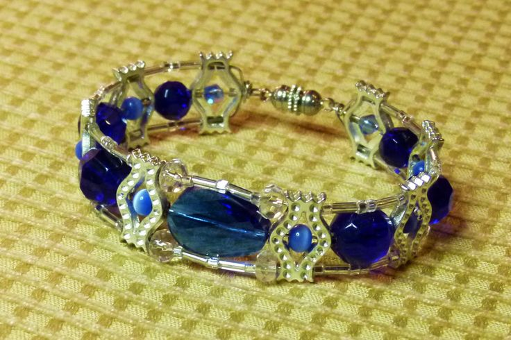 This is a bracelet made by Kathy Stewart (Canada). It is a one-of-a-kind piece. To see more of her eclectic jewelry please go to www.glamnglitter.com