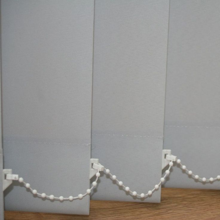 Vertical Blinds - White Vertical Blackout Blinds made from a plain white fabric. These vertical blinds are also availble as non blackout.