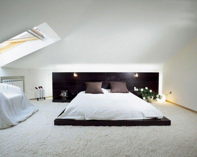 Стильная минималистская спальня с кроватью на низком подиуме
