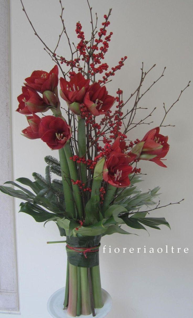 Fioreria Oltre/ Fresh flower arrangement/ Red amaryllis, ilex, greenery
