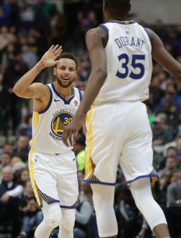 Golden State Warriors forward Kevin Durant (35) celebrates a play with teammate Kevin Durant (35) during the first half of an NBA basketball game against the Dallas Mavericks in Dallas, Wednesday, Jan. 3, 2018. (AP Photo/LM Otero)