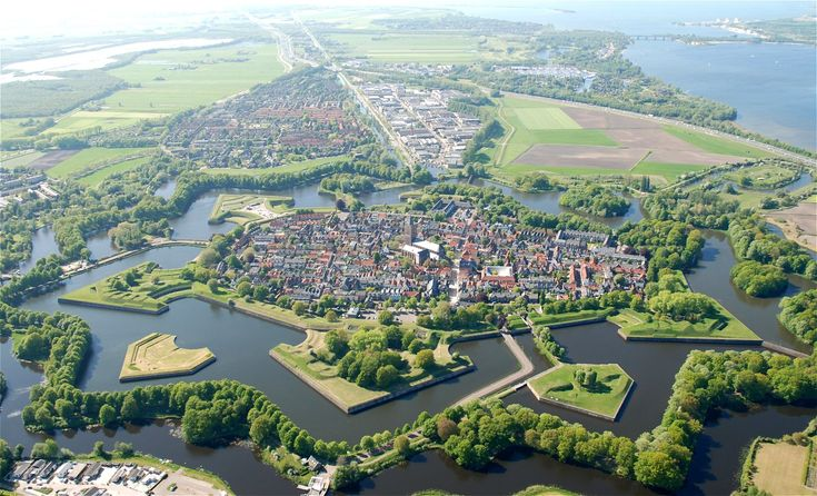 Naarden is a municipality and a town in the Gooi region in the province of North Holland in the Netherlands. Naarden is an example of a star fort, complete with fortified walls and a moat. The moat and walls have been restored and are currently in excellent condition.