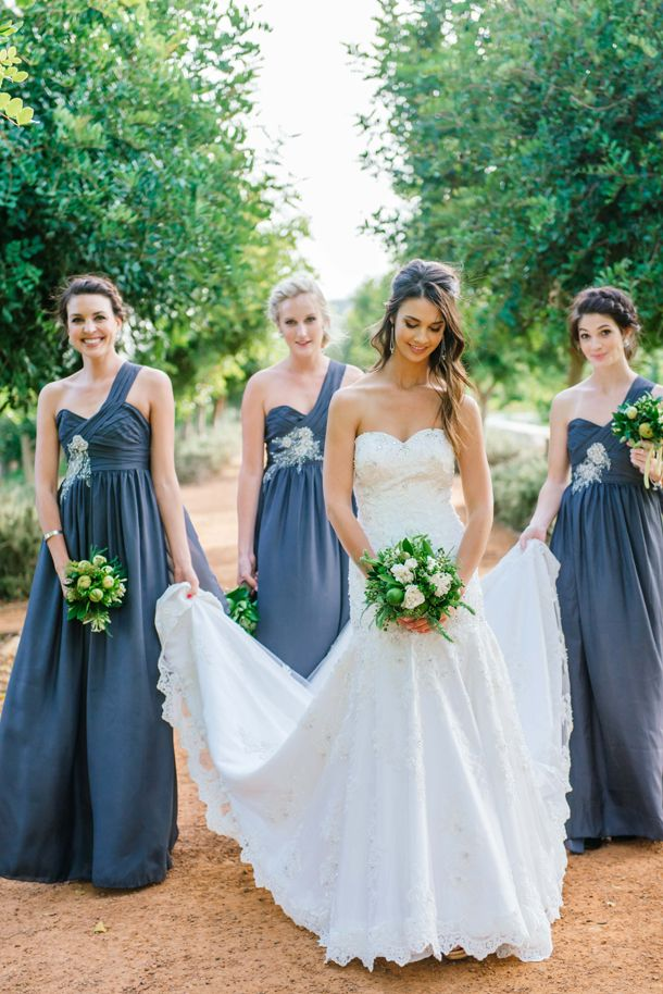 Pewter grey bridesmaids & citrus bouquets | SouthBound Bride | http://www.southboundbride.com/fruitful-farm-wedding-at-babylonstoren-by-claire-thomson-simona-emile | Credit: Claire Thomson