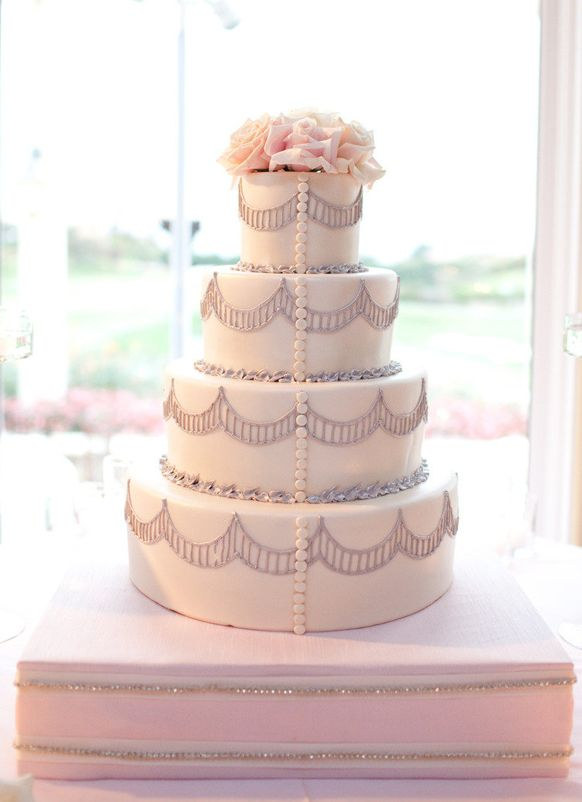 blush 4 tier pink and silver luxury with button details wedding cake