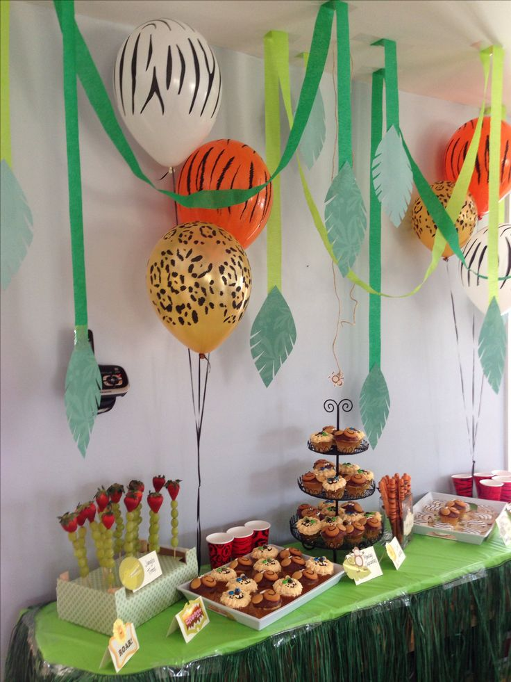Lion tiger zebra and monkeys at the jungle dessert table!  Jungle theme first birthday party