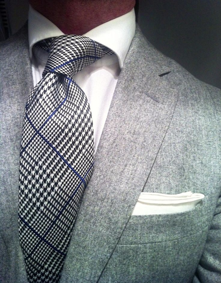 Light charcoal jacket, patterned tie, crisp white shirt and pocket square