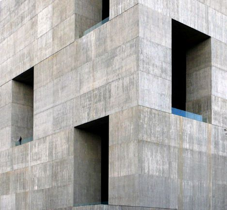 This concrete innovation centre at a Chilean university has deep recessed windows designed to cool its network of communal interior spaces.