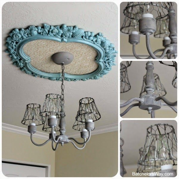 This was a cheap plastic frame she got for $4 at a thrift shop, painted it, put wallpaper in the center, and planted a chandelier in the middle.  Genius and gorgeous! Batchelors Way: Rustic charm Bedroom - Light it Up!!