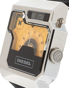 Oversized watch with canvas strap by Diesel.