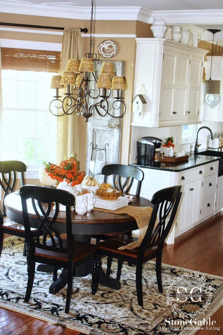 10 ELEMENTS OF A FARMHOUSE KITCHEN  luv the cute lil' birdhouse on the end of the upper cabinet and the table and chairs are to die for