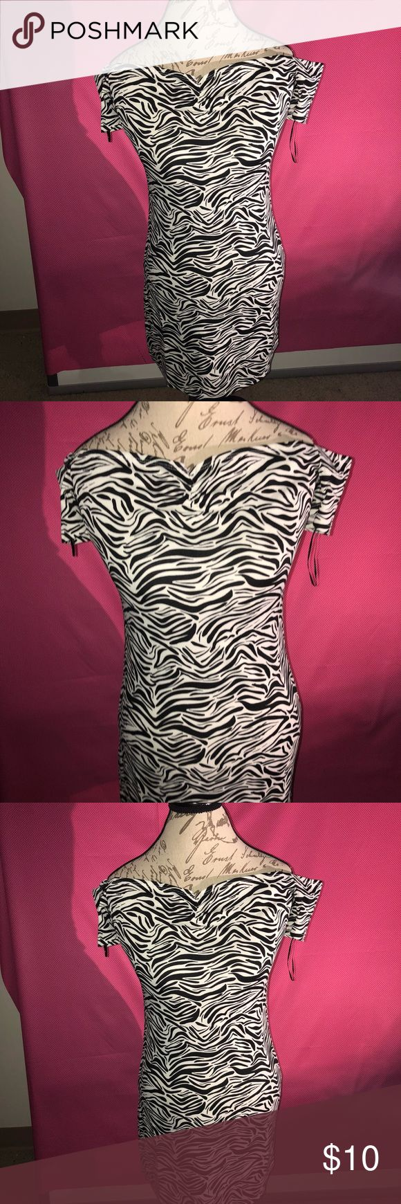 Gorgeous Zebra Print Dress Gorgeous off the shoulder zebra print dress, never worn! Perfect for the night out at the club and getting ready for that 2018 year!!! Dresses Midi